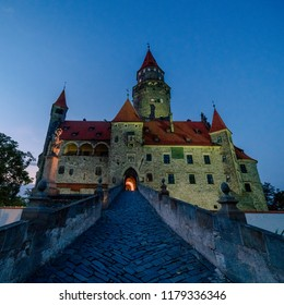 Picture of Bouzov castle from the front at night.