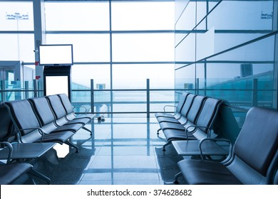 A picture of a brand new departure lounge at the airport, blue tone