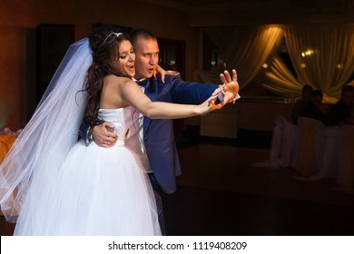 A picture of the bride and groom dancing after the ceremony
