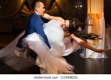 A picture of the bride and groom dancing after the ceromony