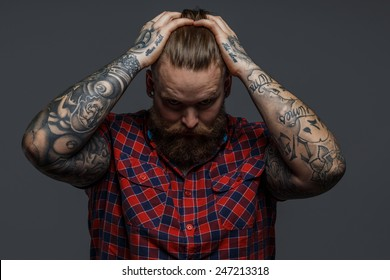Picture of brutal tattooed male with beard
