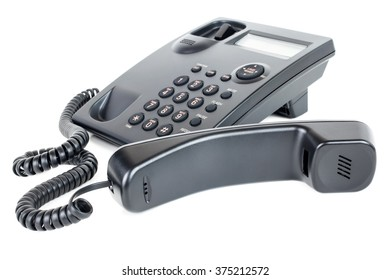 Picture of a business landline telephone with the receiver off the hook laying in front of the phone