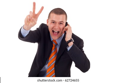 picture of a business man making victory sign while talking on the phone