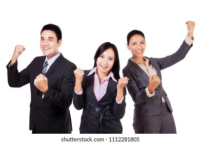 Picture of business team celebrating their success by lifting hands, isolated on white background