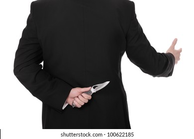 A picture of a businessman hiding a knife behind his back and greeting somebody over white background