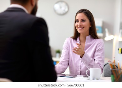 Picture of businesspeople talking in office