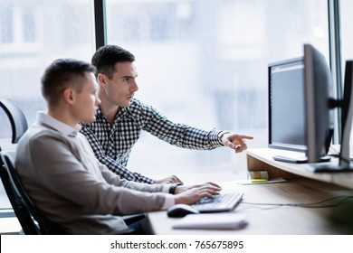 Picture of businesspeople working on computer together