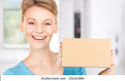 picture of businesswoman with parcel in office