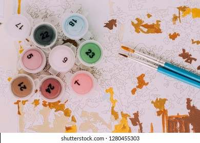 Picture by numbers. Drawing on canvas. Numbered paint cans. Creative hobby. Painting for beginners. Novice artist. Art idea.Brushes and paints