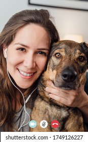 picture of call screen of woman making a video call next to her dog
