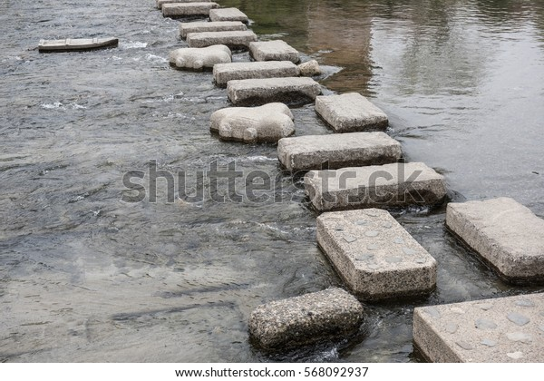 In the picture it can be seen how stones are used to control the water flows in japan.