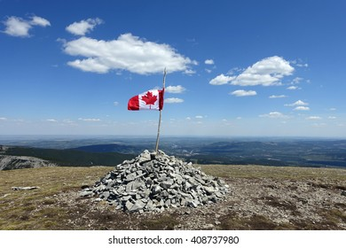 Picture of a Canadian flag on top of Prairie Mountain in Kananaskis, Alberta, Canada.