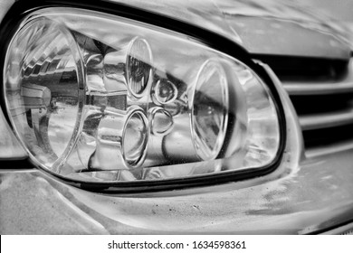 Picture of a car headlight in black and white