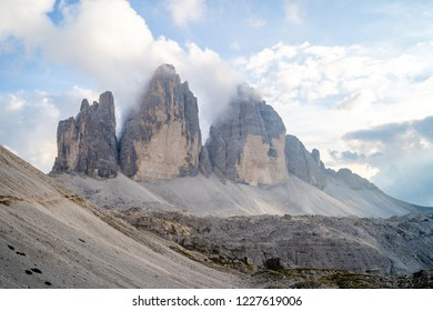 A picture of the celebrated Tre Cime di Lavaredo  (Drei Zimmen) in sunshine with few nice clouds around them. They are problably one of the best known group of the alps.