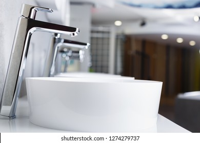 Picture of ceramic wash basin with chrome tap in bathroom fitment store