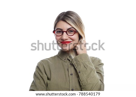431213f0ad Picture of charming young woman in stylish eyewear looking at camera with  cute smile