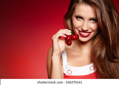 picture of cherry and lips over red background