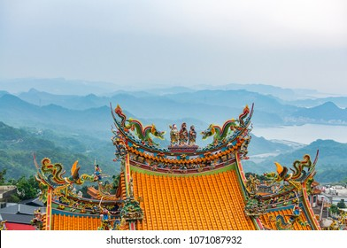 Picture of Chinese style temple's roof with mountain in background at Jiufen, Taiwan.