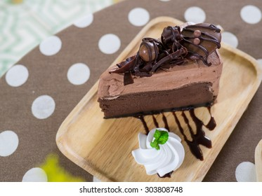Picture of Chocolate Cake On Wooden Plate