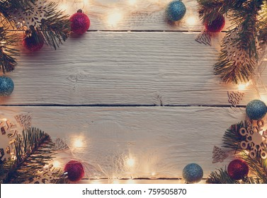 Picture of Christmas gray surface with burning garland, branches of spruce, balls