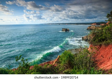 picture of cliff with blue water and golden beach in Indonesia. Bengkulu view from the top view from the top of the mountain. A travel paradise destination for couples in search of adventure.