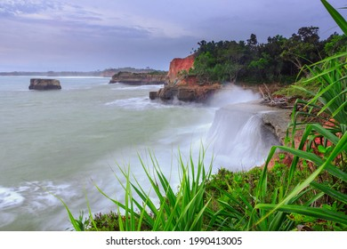 picture of cliff with blue water waves in Bengkulu Indonesia, sea view from the top of the mountain and sunset. Travel paradise destination for adventure.