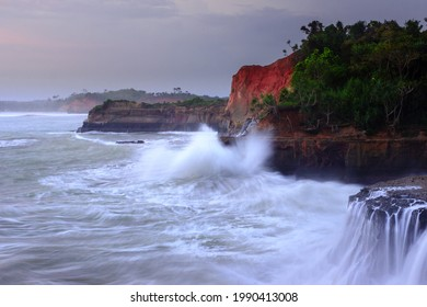 picture of cliff with blue water waves in Bengkulu Indonesia, sea view from above the view from the top of the mountain. Travel paradise destination for adventure.