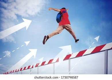 Picture of college student jumping through obstacles line with upward arrow while carrying bag