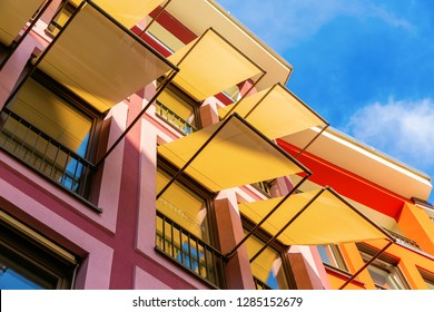 picture of colorful house facades with awnings