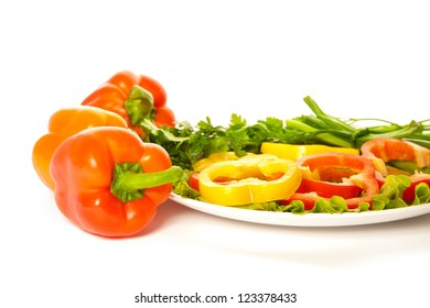 Picture of colorful peppers and a plate of salad isolated on white