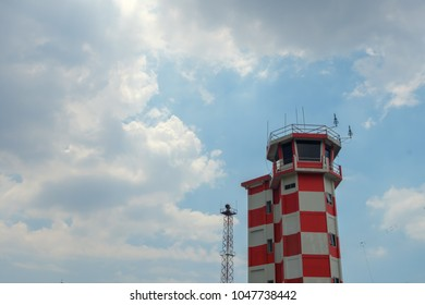 picture of colorful red and white ATC tower