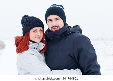 Picture of a couple in love on a winter background