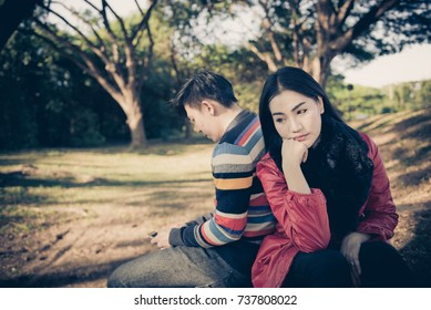 A picture couples of asian on valentines day at tunnel trees,Thail woman sad because of her lover to ignore her,A man have a new girlfriend