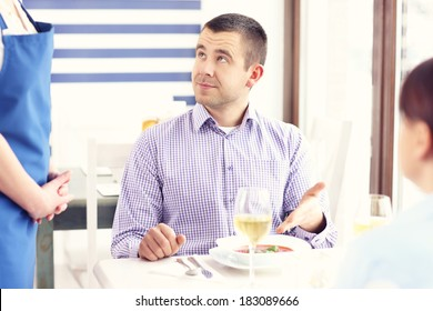 A picture of a customer complaining about the food in a restaurant