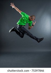 picture of dancer jumping on grey background