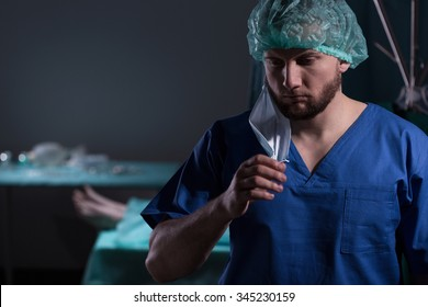 Picture of despair doctor after failed medical operation