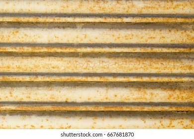 Picture of detail of a yellow blind made of metal. Texture