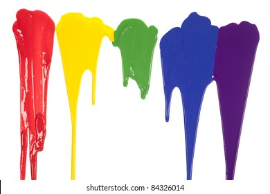 A picture of different colors of paint dripping.