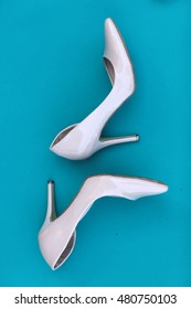 A picture of different shoes, Shot of several types of shoes, Several designs of women shoes. Leather Shoe. Pile of various female shoes on on light blue background. Copy space for text.