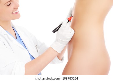 A picture of a doctor marking abdomen for plastic surgery