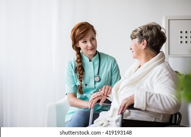 Picture of doctor supporting ill senior woman during treatment