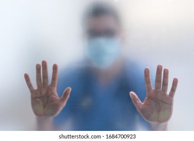 picture of a doctor via window of quarantine unit in the hospital asking for help of protection and support. coronavirus, covid 19, medical, healthcare concept