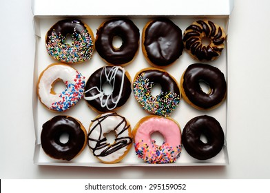 Picture of donut box with one dozen assorted doughnuts