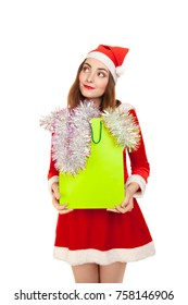 Picture of dreaming woman in costume with new year shopping bag