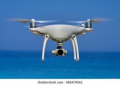 Picture of drone flying with sea in background ( blue background)