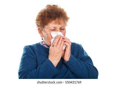 Picture of an elderly woman blowing her nose - isolated background