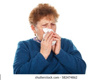 Picture of an elderly woman blowing her nose