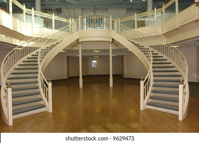 A Picture Of A Fancy Staircase With Curves