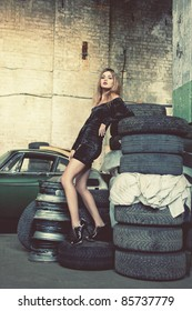 picture of fashionable woman in retro garage