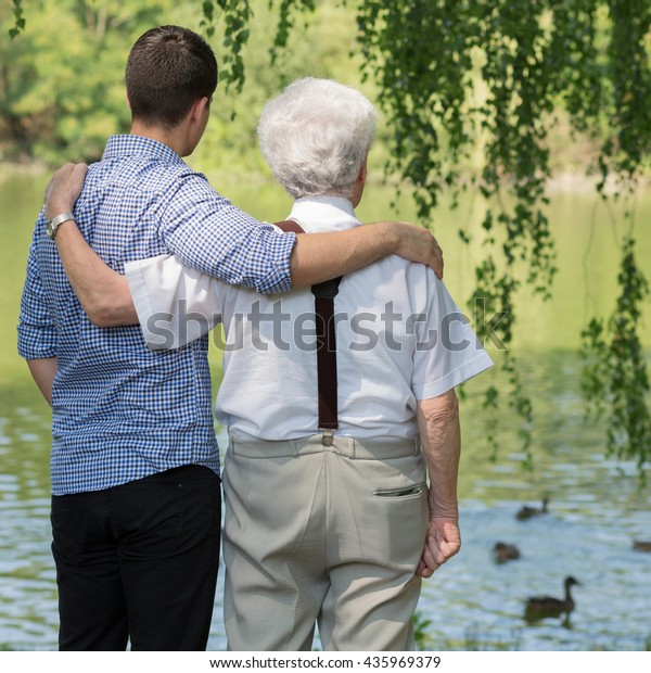 Picture of father and son spending leisure time in park